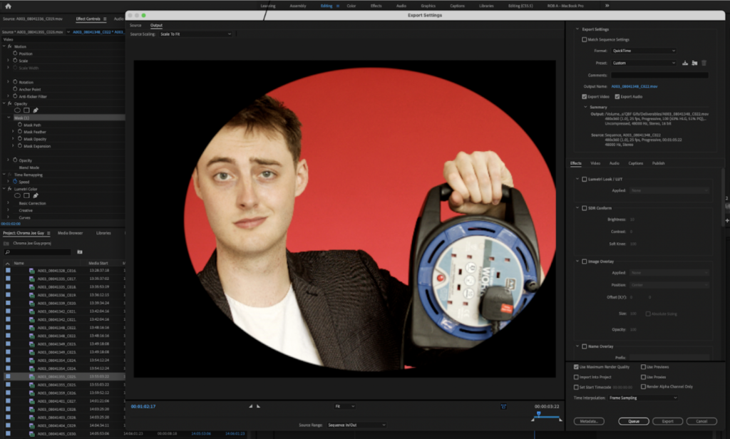 in a video editing application, a young man with a moire pattern on his blazer smirks at the camera